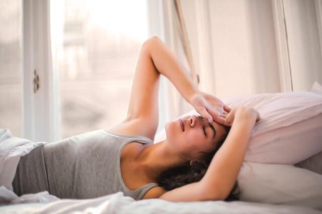 Woman suffering migraine headaches